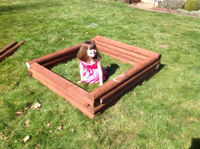 My little helper sitting in her garden box