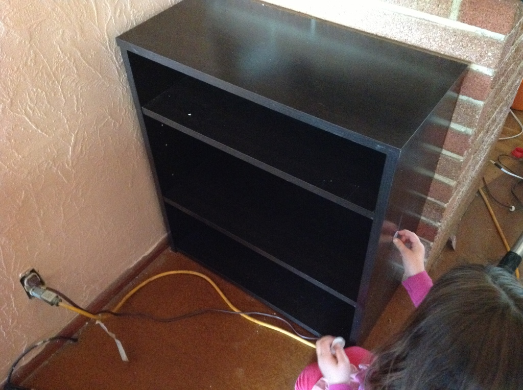 Nice short shelf with my little helper removing the stickers