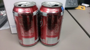 Start off with two of the same type of soda.  Different soda cans may look the same size but often are not