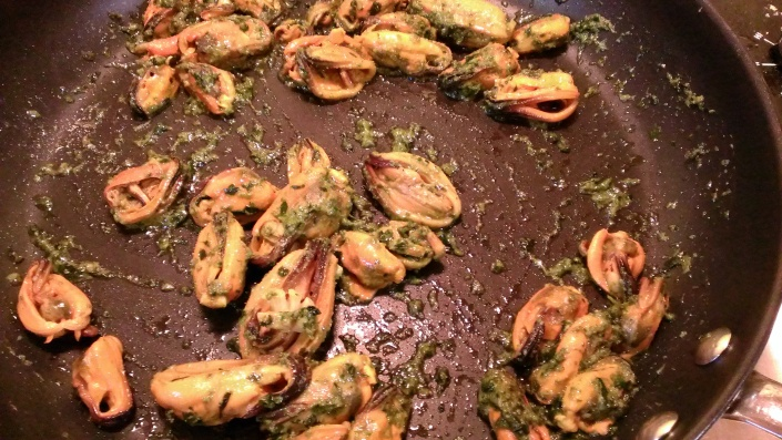 Mussels and pesto blending together