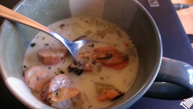 Tasty bowl of chowder with mussels and sausage.